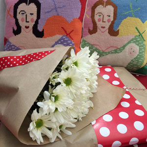 Mother and Child cushions with a gift wrapped kit ready for the post.
